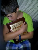 Asleep on the bus with the sportsmanship award. How cute.