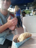 Mike clapping for his hot dog.